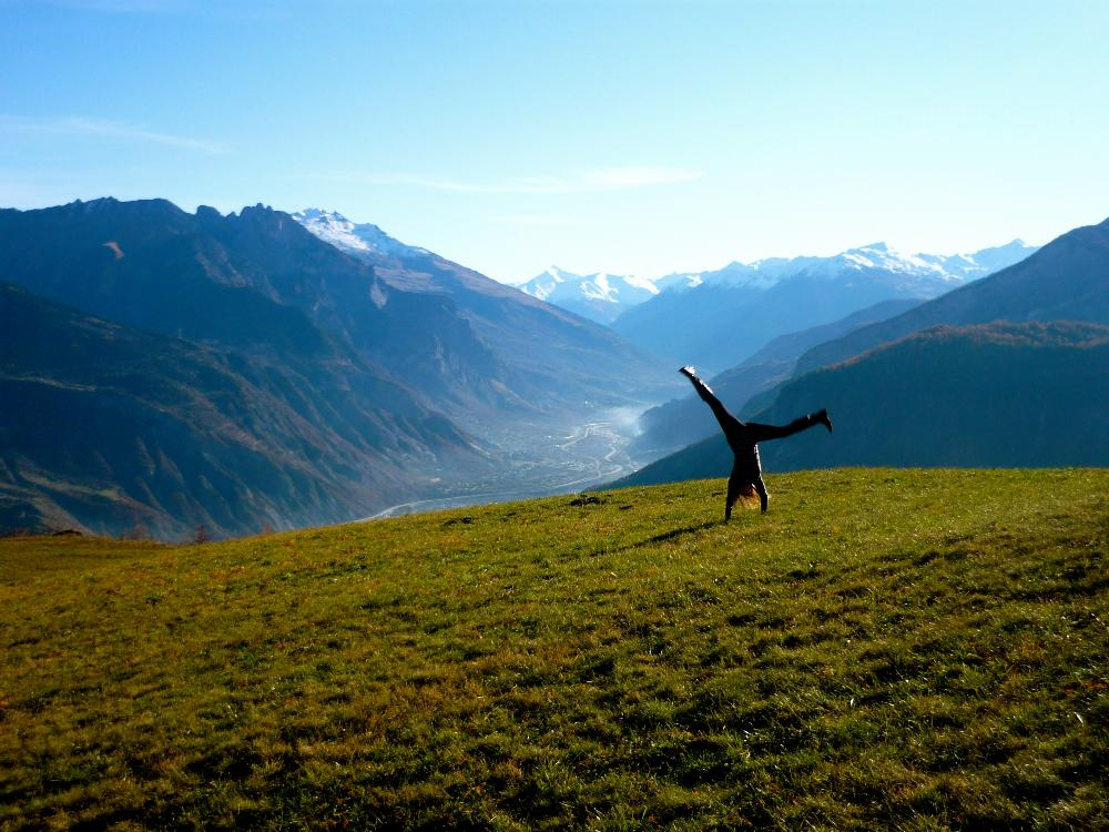 Student doing a  handstand in French mountains